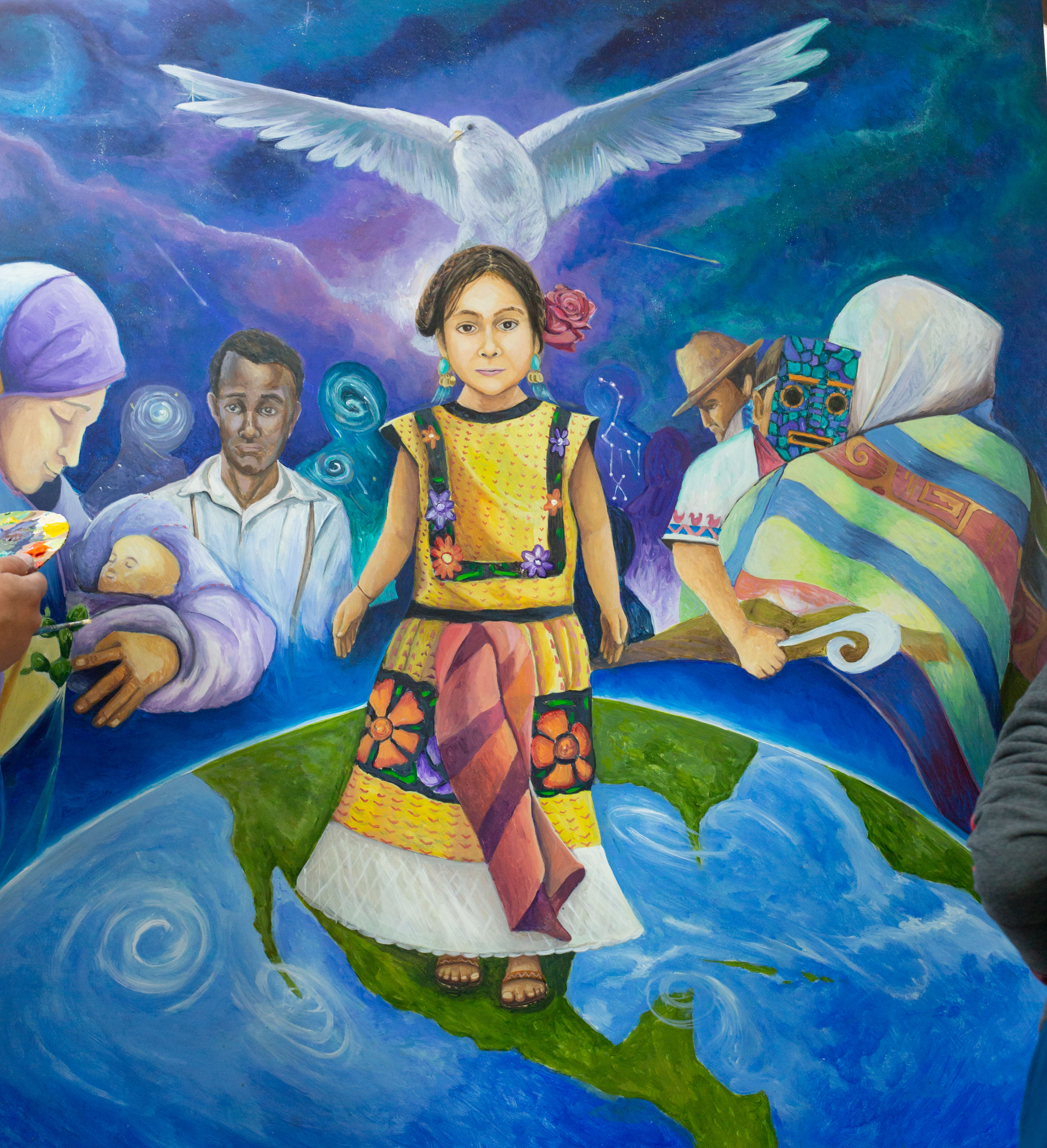 Image of young migrant child from Canal Alliance mural